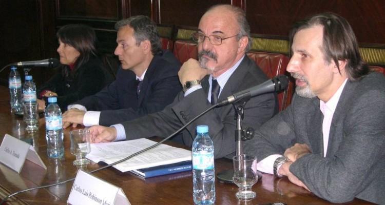 María Granda, Diego Fernández Madrid, Carlos A. Tomada y Carlos L. Robinson Marin